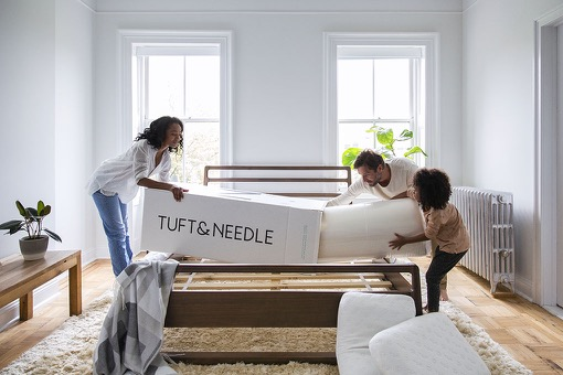 Family unboxing their Tuft & Needle mattress